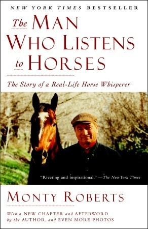 man listens to horses